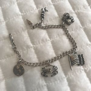 Jewelry - Sterling silver charm bracelet and charms. 7 1/2""